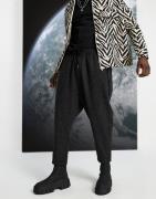 ASOS DESIGN - Posede bukser i sort nep